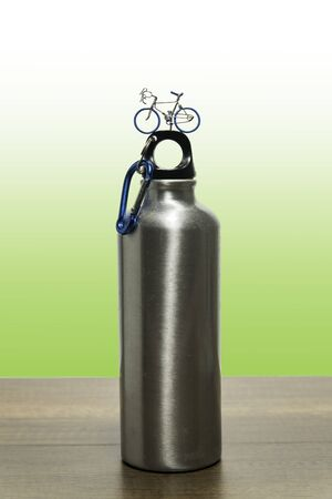 Stainless flask with one small bicycle model on top