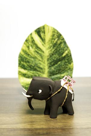 Elephant clay with one green leaf