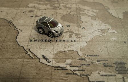 One toy car park on United states country in world map Stock Photo