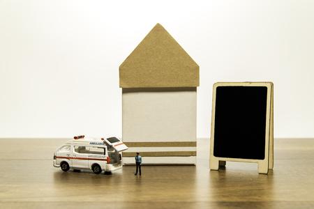 Van ambulance and policeman near building and blank black board