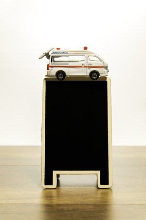 Van Ambulance over blank black board