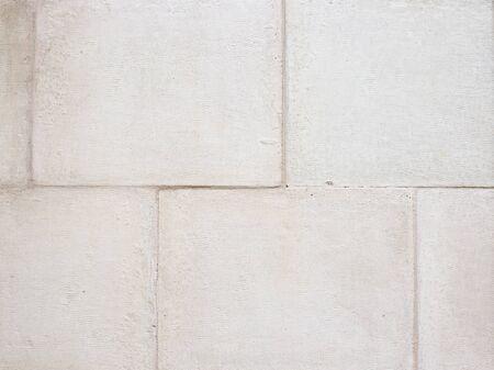 White stone brick wall texture background. Macro view