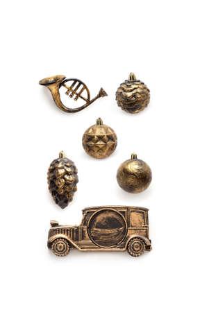 Christmas set of vintage blackened gold decorations isolated on white Stock Photo