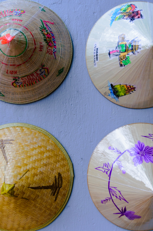 coolie hat: Palm-leaf conical hat (Non-La) is a traditional symbol of vietnam and is a special souvenir for tourist