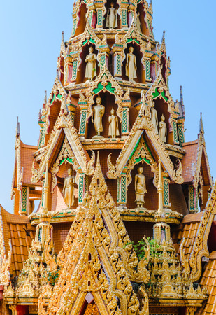 sua: Delicate Thai art rooftop of temple  with several buddha staues at Tiger Cave Temple (Wat Tham Sua), Kanchanaburi Province, Thailand