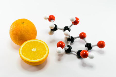 Orange and vitamin C structure model (Ascorbic acid) on white background for education Stock Photo