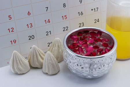 songkran: Calendar of Songkran Festival (Thailand New Year) during 13-15 April with the concept of a silver bowl filled with a white powder and Thai perfume and decorated with rose petals for water sprinkling Stock Photo