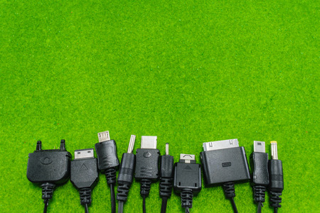 universal: Multi-heads of mobile phone charger (Universal charger) on green background