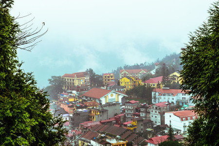 cai: View of Sapa city in the morning with tree frame, Sapa, Lao Cai, Vietnam