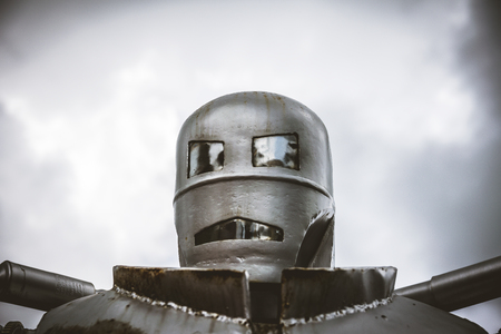 steel head: Head shot of steel retro robot with cloudy sky background