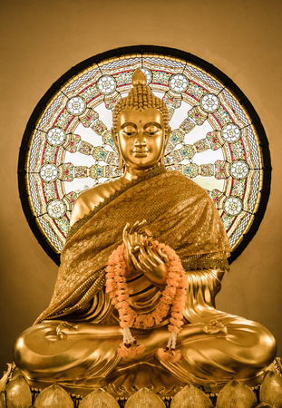 buddha tranquil: Buddha statue and Wheel of life background made from mosaic