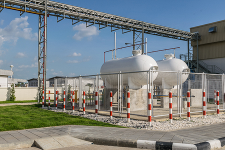 precaution: LPG cylinder tank isolated in safety zone inside a fence, Safety precaution concept Stock Photo