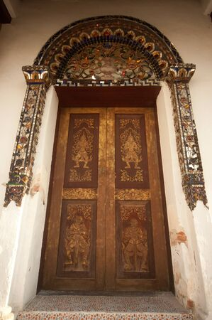 Ancient door at Myanmar temple in NOrthern of Thailand   photo