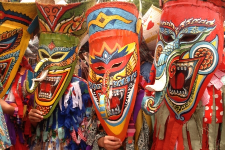 LOEI, THAILAND - JULY 1  Unidentified young people dress in spirit and wear a mask, sing and dance Phi Ta Khon Festival   Ghost mask festival   on July 1, 2011 in Loei, Thailand