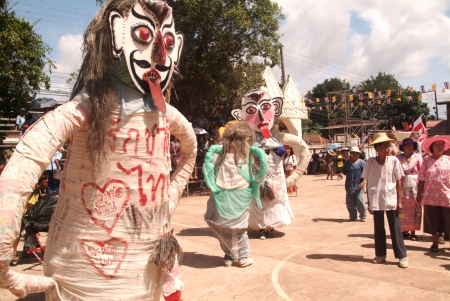 LOEI, THAILAND - JULY 1  People dress in spirit and wear a big mask, show sing and dance is traditional cullture in Ghost mask festival  Phi Ta Khon Festival  on July 1,2011 in Loei, Thailand