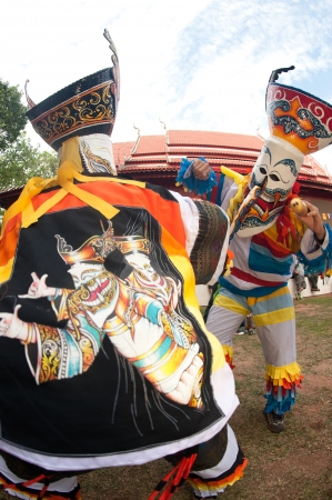 LOEI, THAILAND - JUNE 23  Phi Ta Khon Festival   Traditional ghost mask festival   Young people dress in spirit and wear a mask, sing and dance on June 23,2012 in Loei Province,Thailand