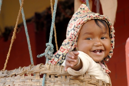 SARANKOT, NEPAL -MARCH 20  Unidentified sherpa baby on March 20, 2012 in Sarankot, Everest Region, Nepal  Sherpa are an ethnic group from Nepal, highly regarded as elite mountaineers, Nepal