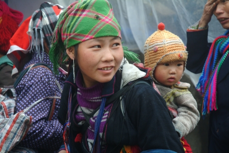 BAC HA, VIETNAM - AUG 29   Unidentified women of the Flower H mong Ethnic Minority People at market on August 29, 2011 in Bac Ha, Vietnam  H mong are the 8th largest ethnic group in Vietnam
