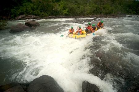 PRAJINBURI,THAILAND -AUGUST 19     Dragoneye  team in action at Rafting racing Hinperng s got challenge 2012 on Saiyai river in Khao Yai National park on August 19,2012 in Prajinburi,Thailand