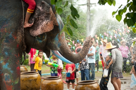 AYUTTAYA, THAILAND - APRIL 14  Songkran Festival is celebrated in a traditional New Year s Day from April 13 to 15, with the splashing water with elephants on April 14, 2012 in Ayuttaya, Thailand   Editorial