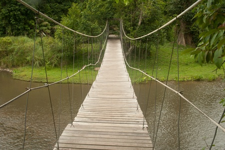 Hanging bridge across river  photo