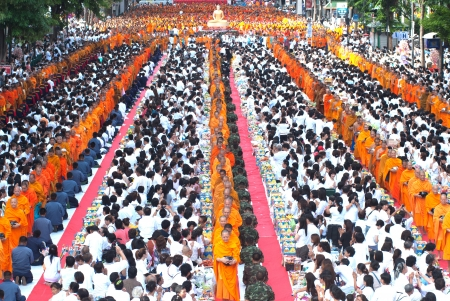 harity event: BANGKOK , THAILAND - MAY 8  unidentified people give food offerings to Buddhist monks on May 8, 2011 Pratunam in Bangkok, Thailand  Thai traditional Ceremony