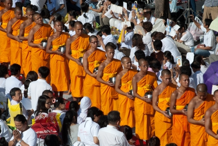 BANGKOK , THAILAND - MAY 8  unidentified people give food offerings to Buddhist monks on May 8, 2011 Pratunam in Bangkok, Thailand  Thai traditional Ceremony