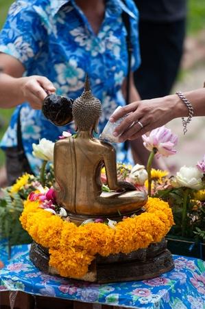 songkran: AYUTTAYA,THAILAND-A PRIL 13   People showering buddha statue in Songkran festival in temple,Ayuttaya,Thailand