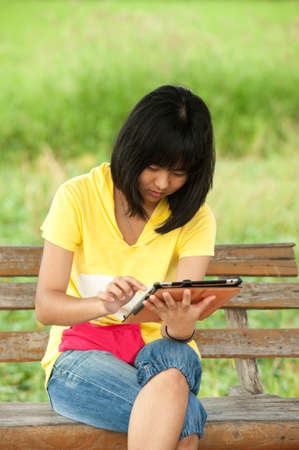 Young girl with tablet   photo
