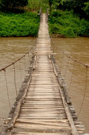 Hanging bridge across river in Northern of Thailand