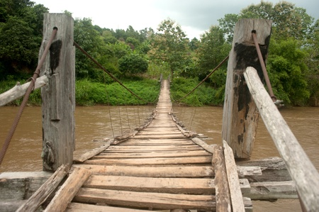 Hanging bridge across river in Northern of Thailand   photo