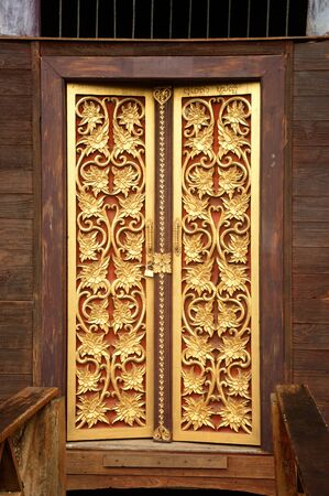 Thai art at temple door  photo