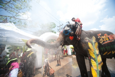 AYUTTAYA, THAILAND - APRIL 13  Songkran Festival is celebrated in a traditional New Year s Day from April 13 to 15, with the splashing water with elephants on April 13, 2012 in Ayuttaya, Thailand  Editorial