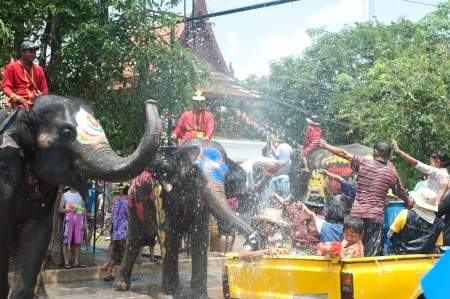new year s day: AYUTTAYA, THAILAND - APRIL 13  Songkran Festival is celebrated in a traditional New Year s Day from April 13 to 15, with the splashing water with elephants on April 13, 2012 in Ayuttaya, Thailand  Editorial