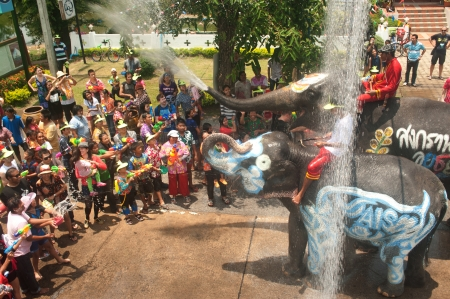 AYUTTAYA, THAILAND - APRIL 13  Songkran Festival is celebrated in a traditional New Year s Day from April 13 to 15, with the splashing water with elephants on April 13, 2012 in Ayuttaya, Thailand   Stock Photo