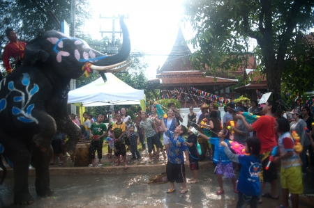 new year s day: AYUTTAYA, THAILAND - APRIL-13   Songkran Festival is celebrated in a traditional New Year s Day from April 13 to 15, with the splashing water with elephants on April 13, 2012 in Ayuttaya, Thailand   Editorial