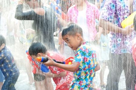 AYUTTAYA,THAILAND-APRIL 13  unidentified People celebrating Songkran  Thai new year   water festival  child and his water gun on road April 13, 2012 in Ayuttaya, Thailand