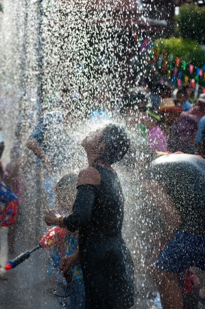 AYUTTAYA, THAILAND - APRIL 13  Songkran Festival is celebrated in a traditional New Year s Day from April 13 to 15, with the splashing water with elephants on April 13, 2012 in Ayuttaya, Thailand