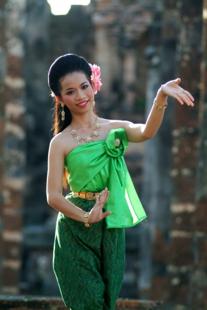 Pretty woman in traditional dance in Middle of Thailand