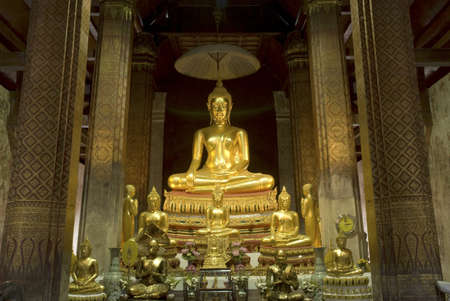 Beautiful ancient golden buddha in Temple of Petburi province in Middle of Thailand