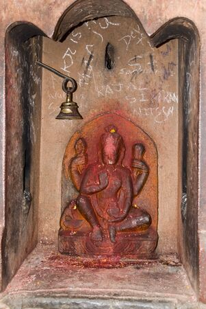 Goddess and bell at Pashupatinath Temple , Kathmandu, Nepal photo