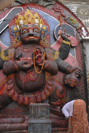 Woman Praying at Kali in Kathmandu, Nepal   photo