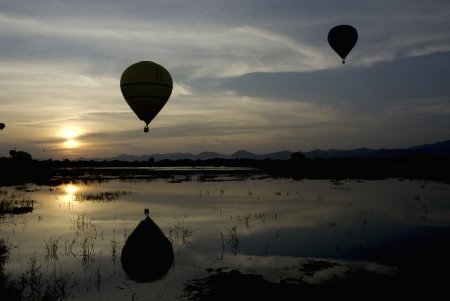 Balloon at sunset above the lake Stock Photo - 16174726
