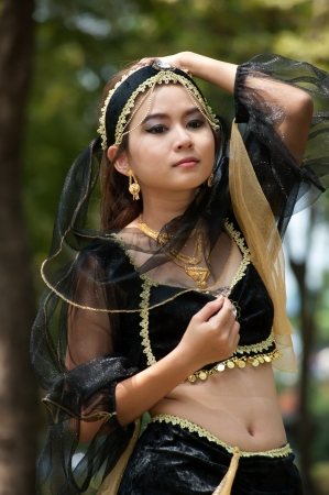 beautiful indian girl face: Pretty Asian woman in black Indian clothes in posing  Stock Photo