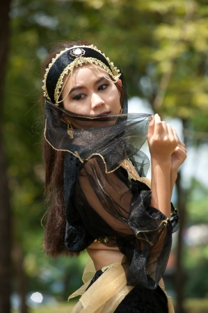 Pretty Asian woman in black Indian clothes in posing  Stock Photo
