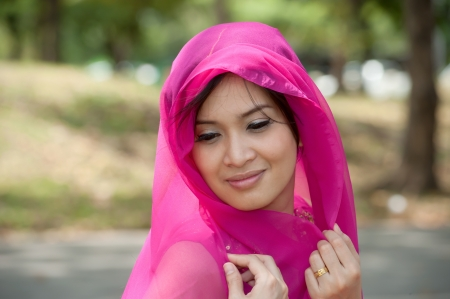 Pretty Asian woman in Pink Indian clothes in posing   photo