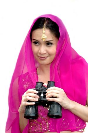 Pretty Asian in pink Indian clothes with binocular  photo