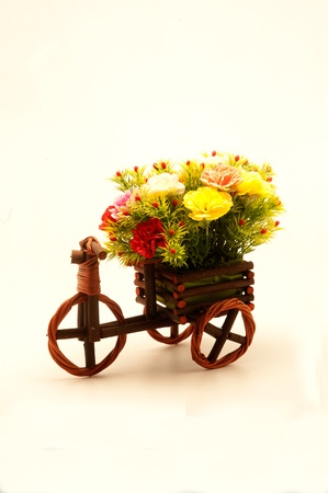 Souvenir paper flowers in little rattan tricycles  photo