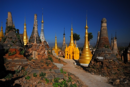 Group of golden pagodas of Shwe Inn Taing Paya near Inle lake, Myanmar