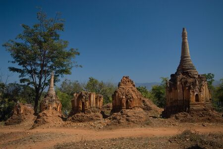 Row of pagodas in Buddhist temple on the border of Inle lake , Myanmar  photo